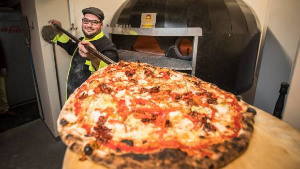 Stefano's Pizza of Nelson executive chef Gaetano Arico makes some pizzas in the new oven, the only known one in New ...