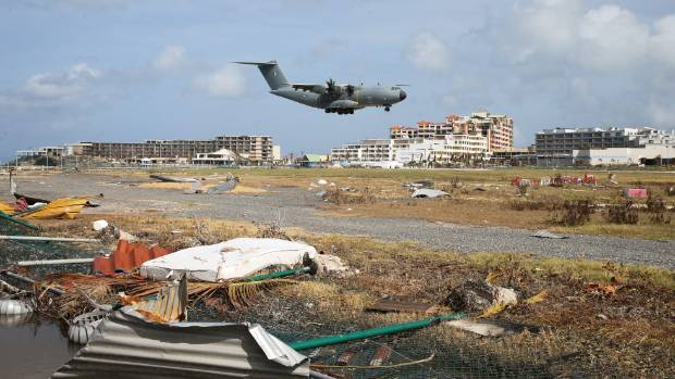 A rescue plane lands at the Princess Juliana Airpot in Saint Maarten after Hurricane Irma devastated this Caribbean ...