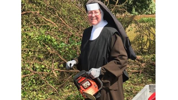 Chainsaw wielding nun shows everyone how to clean up after a if you want something done just do it yourself could be sister margaret anns solutioingenieria Image collections