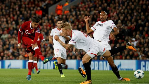 Roberto Firmino, left, was among the goal scorers as Liverpool drew 2-all with Sevilla in the Champions League on ...