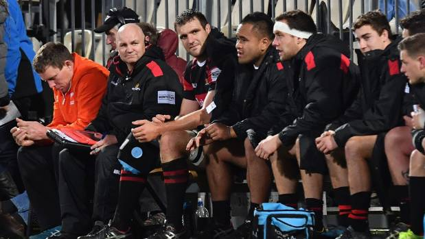Canterbury captain Luke Whitelock, centre, ices his right-knee after being forced off early in the second half against ...