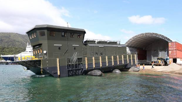 New Zealand King Salmon's new barge is launched with air bags acting as rollers.