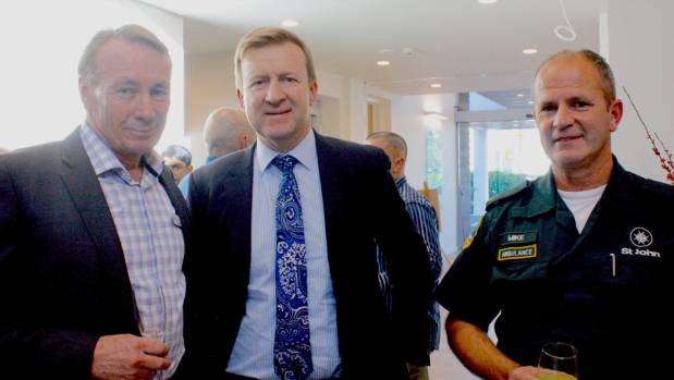 Centre director and GP Peter Boot with Minister of Health Jonathan Coleman and Mike McAulay from St John.
