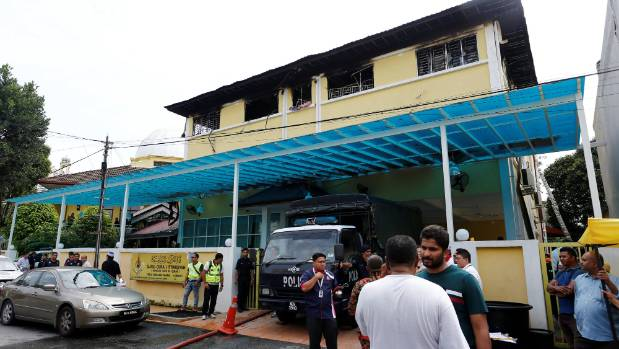 Authorities work at religious school Darul Quran Ittifaqiyah after a fire broke out in Kuala Lumpur, Malaysia.