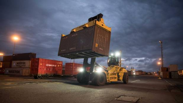 Containers being loaded onto the first freight train to run down the Main North Line from Picton to Christchurch on Friday.
