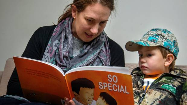 Rochelle Hutson reads David Hill's new book, So Special, to her 4-year-old son, Nathan.