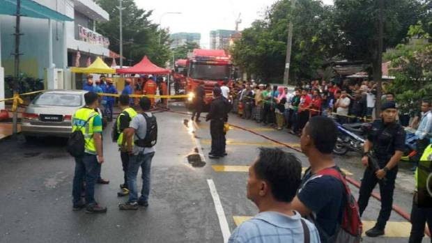 Rescue workers  at the religious school Darul Quran Ittifaqiyah after a fire broke out in Kuala Lumpur, Malaysia.