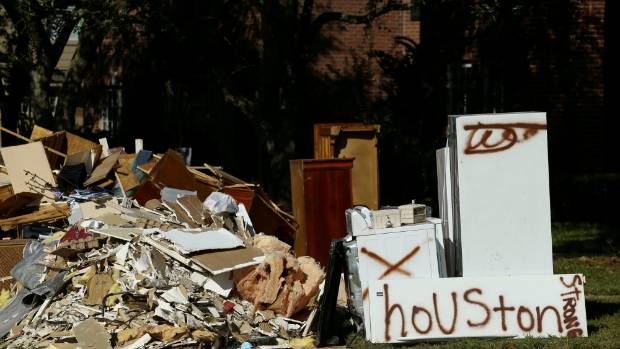 Flood-damaged contents from homes line the roads along residential streets in Houston, Texas.