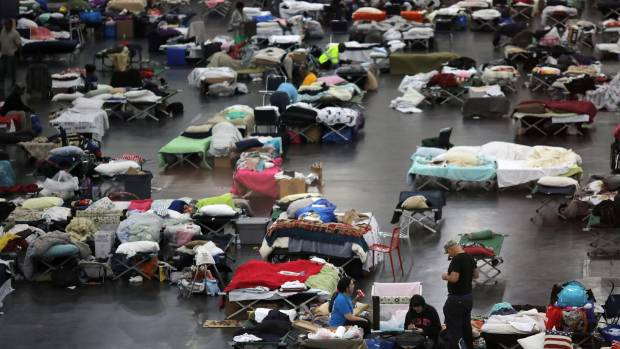 Daniel Vasquez and his family take shelter along with thousands of others at the George R. Brown convention center after ...