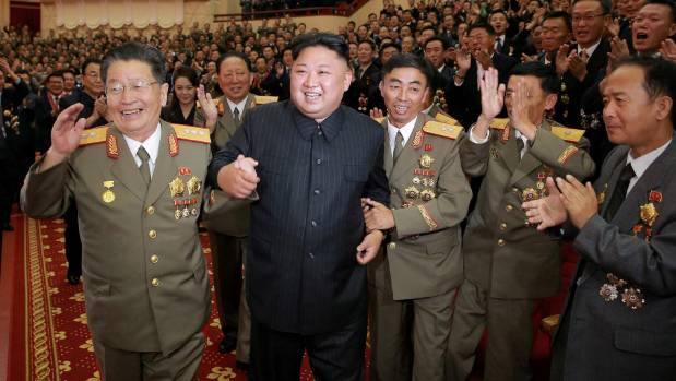 North Korean leader Kim Jong Un reacts during a celebration for nuclear scientists and engineers who contributed to a ...