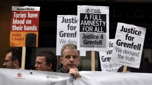 Demonstrators gather outside the Grenfell Tower public Inquiry in central London.