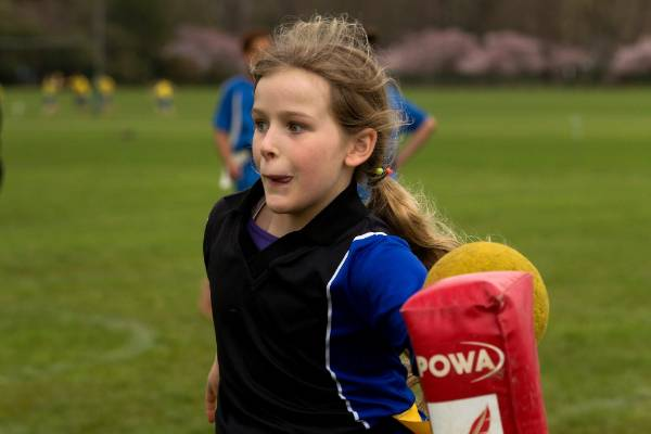 Laura Manning, 10, of Kimbolton School strikes the nga pou (post) with the ball.