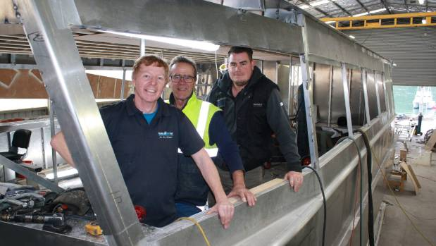 Pelorus Mail Boat owner Jim Baillie, left, with boating subcontractor Warren Algie and TCC Boats manager Matt Byrne in ...