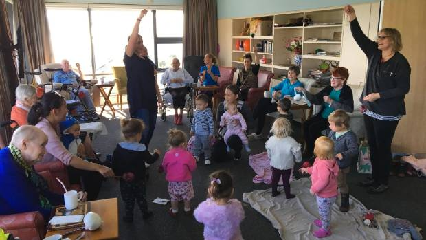 Little Tamariki Montessori Preschool teachers Katie Leckie and Lisa Popebloemers with the Penguin Room class at