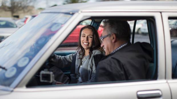 Prime Minister Jacinda Ardern talks to Martin van Beynen in the front seat of the Holden Kingswood on the campaign trail