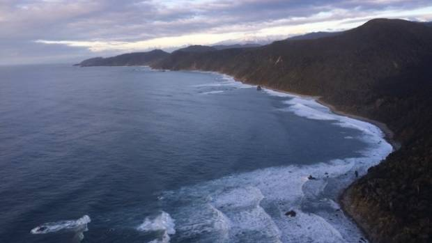 The coastline near Jackson Bay where helicopter and ground crews searched for the two missing boaties.
