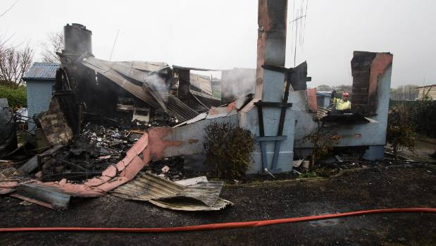 Two people are in hospital after a well involved house fire near Timaru on Tuesday morning.