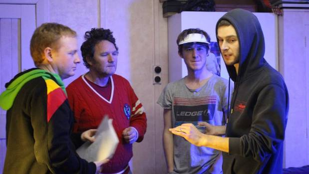 On set of Black Shark, actors Rene Le Bas and Des Morgan (left), speak with directors and writers Kieran Charnock and ...
