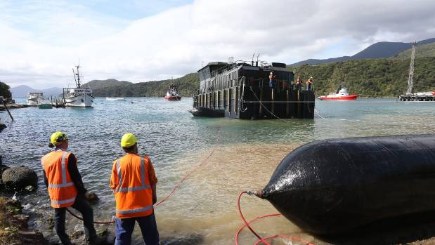 The barge moves safely out into Picton harbour.