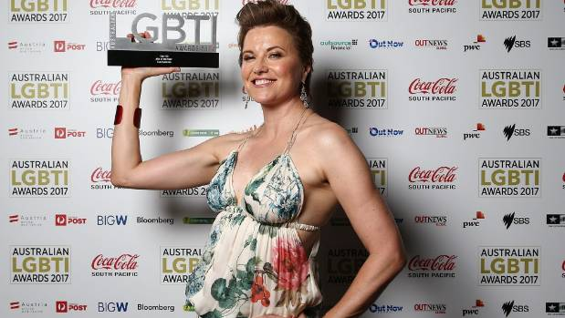 Lucy Lawless poses with the Star 100 Ally of the Year award at the Australian LGBTI Awards 2017, in March.