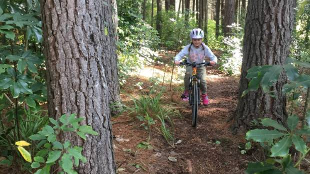 Sofia Mosna enjoys the challenge of a new mountainbike trail for kids at Picton.