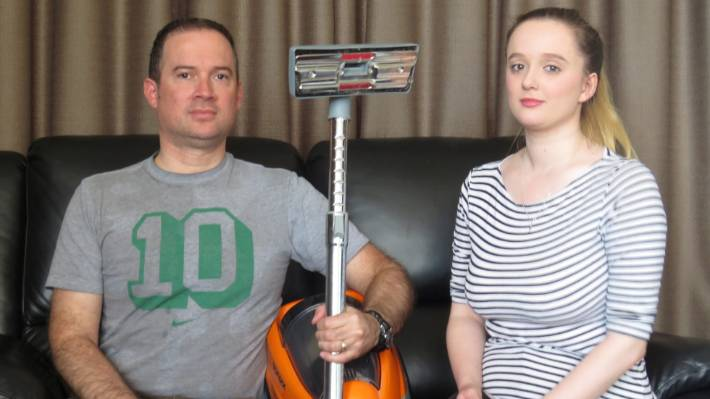 Richard and Olivia Knights, of Dunedin, and a trade-in vacuum cleaner that