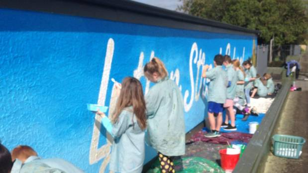 Pupils from Lytton Street School helped paint a mural on a school building.