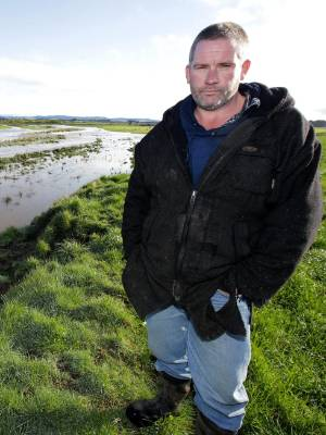 Te Waewae Bay farmer Thomas O'Brien is facing the loss of about 22 hectares of his family farm as water from the Waiau ...
