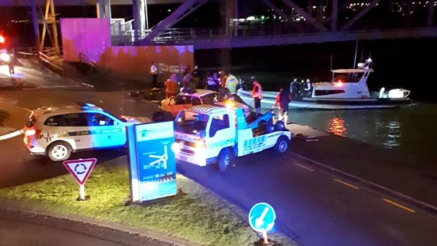 A tow truck is at the scene where a car has plunged into Auckland harbour.