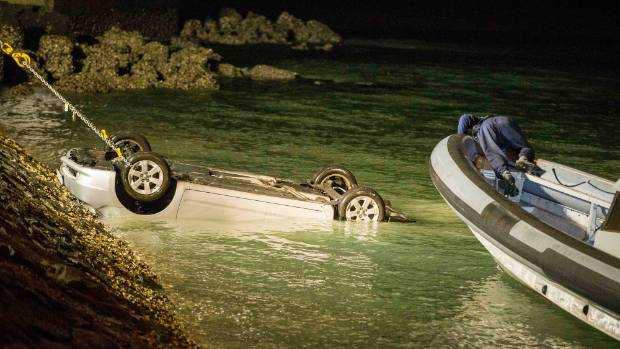 Emergency services have retrieved a car that drove into Auckland harbour, with at least one person inside.