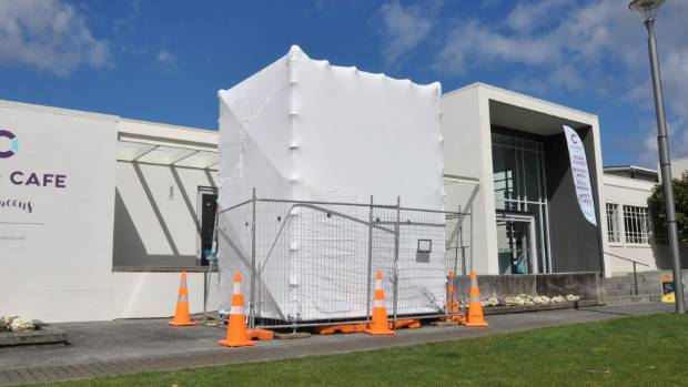 Free Standing Forms encased in scaffolding and plastic wrap to protect it from the weather.