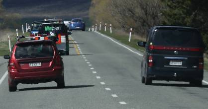 A tale of two overtakes. The vehicle closest to camera is safe but the blue hatchback further up the road is overtaking ...