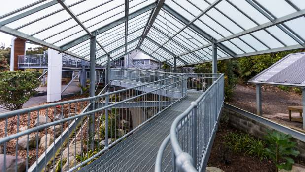 "The ""tree-top walkway"" is an elevated and covered steel path off the Pukeiti entrance."