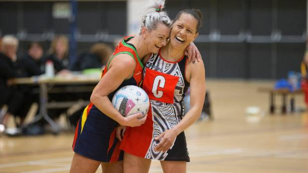 What it's all about. Former team mates, Bridget Gane and Tokomaru rival Tash Ford, share a laugh in the heat of battle ...
