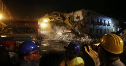 Workers look on a destroyed hotel after an earthquake hit Atlixco, in Puebla state, Mexico, September 19, 2017. ...