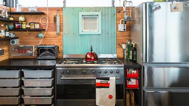 Corrugated iron from an old garage has been used as a novel splashback.