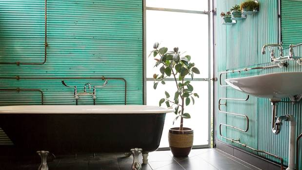 Corrugated iron has been used throughout the spacious bathroom.