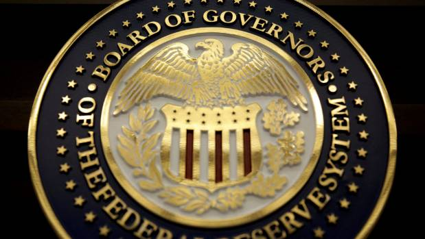 Fed conflicted by tepid US inflation, global economic rebound