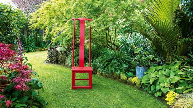 A friend gave her the chair from northern China, on the condition that Elaine painted it bright red.