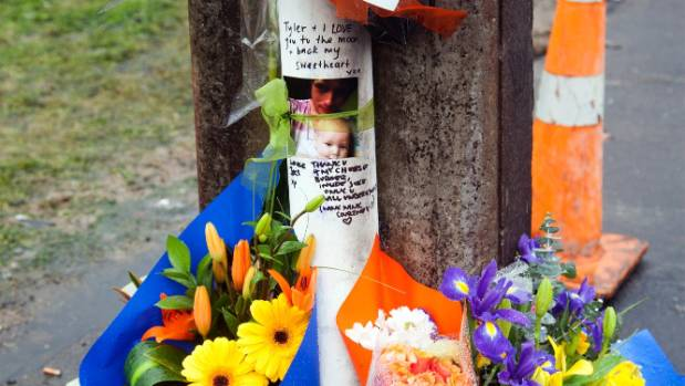 Flowers and notes were placed as tributes on a lamp post at the scene of the horrific car crash in Levin.