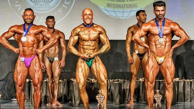Lawrence, centre, won the amateur men's performance class at the WFF (World Fitness Federation) Pan Pacific ...