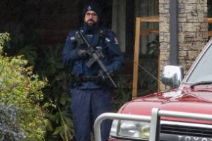 Police guard Andrew Cameron's house near Hanmer Springs on Tuesday morning.