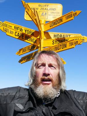 Scottish tourist Geoff Mumford a little confused by the directions for Wellington and Cape Reinga which pointed in ...