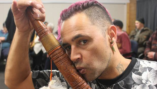 Jerome Kavanagh plays a Taonga Puoro - a traditional Maori musical instrument carved from Rimu - at a workshop on ...