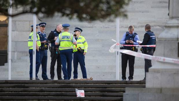 Police gather at the scene on Parliament grounds on Thursday.