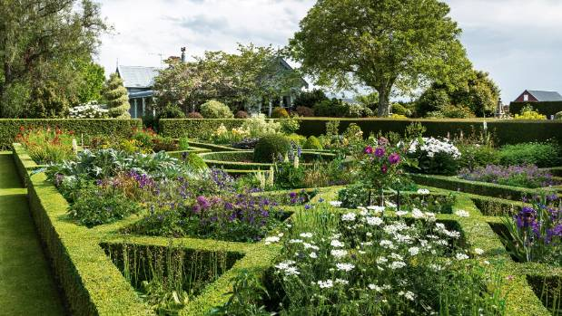 The knot garden's beds are split into reds, blues, whites and yellows, with carefully selected shades and foliage in ...