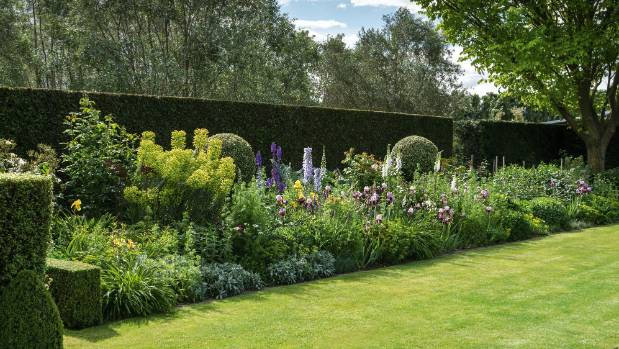 The herbaceous border garden contrasts the restraint of perfect topiary balls with the abandon of rampant blooms; such ...