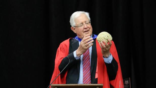 "Sir Richard Faull holds up his ""second brain"", as he explained to the students at New Plymouth Boys' High that they were ..."