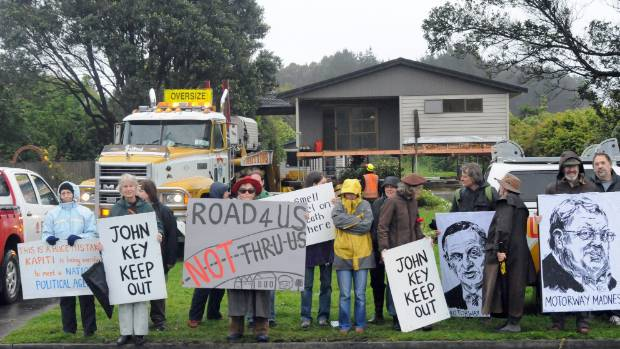 Protesters outside a house in Te Moana Rd, Waikanae, being removed in 2013 to make way for the Kapiti expressway