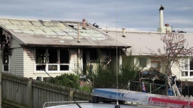 Flames beat back rescuers from blazing Dunedin flat where person ...